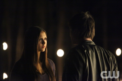 "The Vampire Diaries -- ""Catch Me If You Can"" -- Pictured (L-R): Nina Dobrev as Elena and Ian Somerhalder as Damon (back to camera) -- Image Number: VD411b_114.jpg -- Photo: Annette Brown/The CW -- © 2013 The CW Network, LLC. All rights reserved."