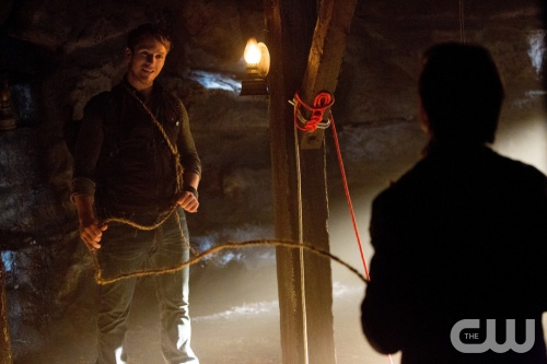 "The Vampire Diaries -- ""Down the Rabbit Hole"" -- Pictured (L-R): Charlie Bewley as Vaughn and Ian Somerhalder as Damon (back to camera) -- Image Number: VD414c_0150.jpg -- Photo: Bob Mahoney/The CW -- © 2013 The CW Network, LLC. All rights reserved."