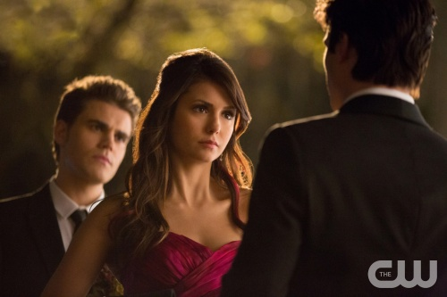 "The Vampire Diaries -- ""Pictures of You"" -- Pictured (L-R): Paul Wesley as Stefan, Nina Dobrev as Elena, and Ian Somerhalder as Damon (back to camera) -- Image Number: VD419a_0544.jpg Photo: Bob Mahoney/The CW -- © 2013 The CW Network, LLC. All rights reserved."